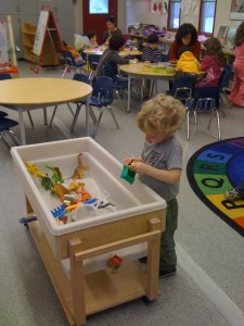 Wesley at play in the StrongStart sandbox. Photo: Briana Tomkinson.