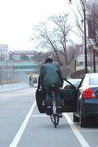 City cyclists share a common fear of being 'doored' (accidentally crashing into an open car door). Photo: Wikimedia Commons