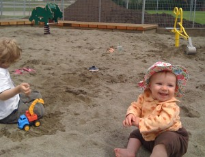A play area geared to younger kids includes a giant sandbox, bouncers, swings and diggers.