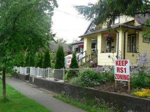 Sapperton residents posted signs to demonstrate opposition to the Elizabeth Fry Society rezoning application. Photo: Will Tomkinson