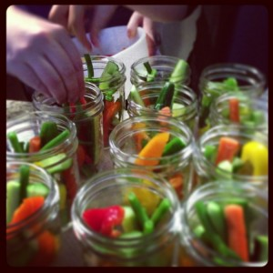 Packing vegetables in jars for pickling