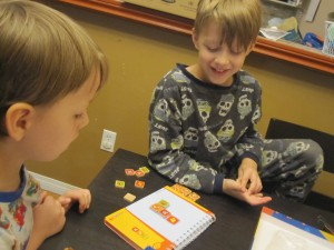 Colleen's boys play logic games as part of their educational activities. Photo: Colleen Baird.