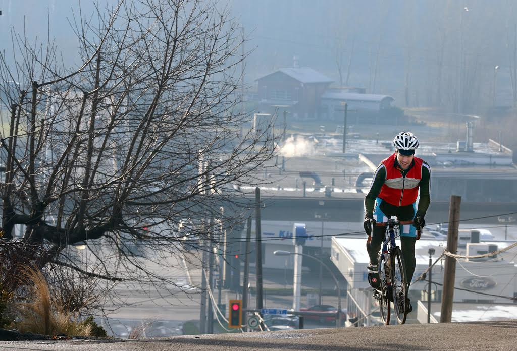 MARIO BARTEL Guy Wilson-Roberts crests the Third Avenue climb from 12th street. He says a good attitude, hard work and a reasonable pace can get any cyclist up New Westminster's hills.