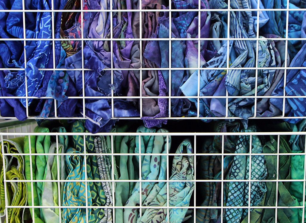 Photo by Mario Bartel Swatches of colourful tie-dyed cotton await transformation into textile paintings.