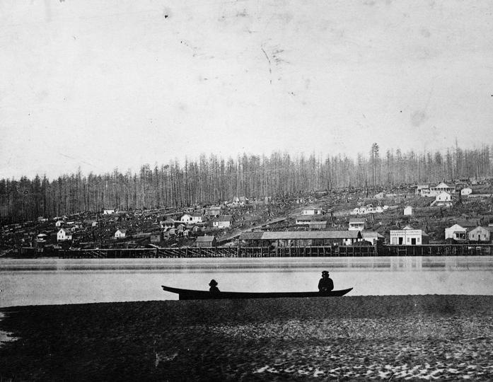 New Westminster Public Library, accession number 278. Photo is approximately circa 1865 and is a general view of New Westminster with a canoe in the foreground.