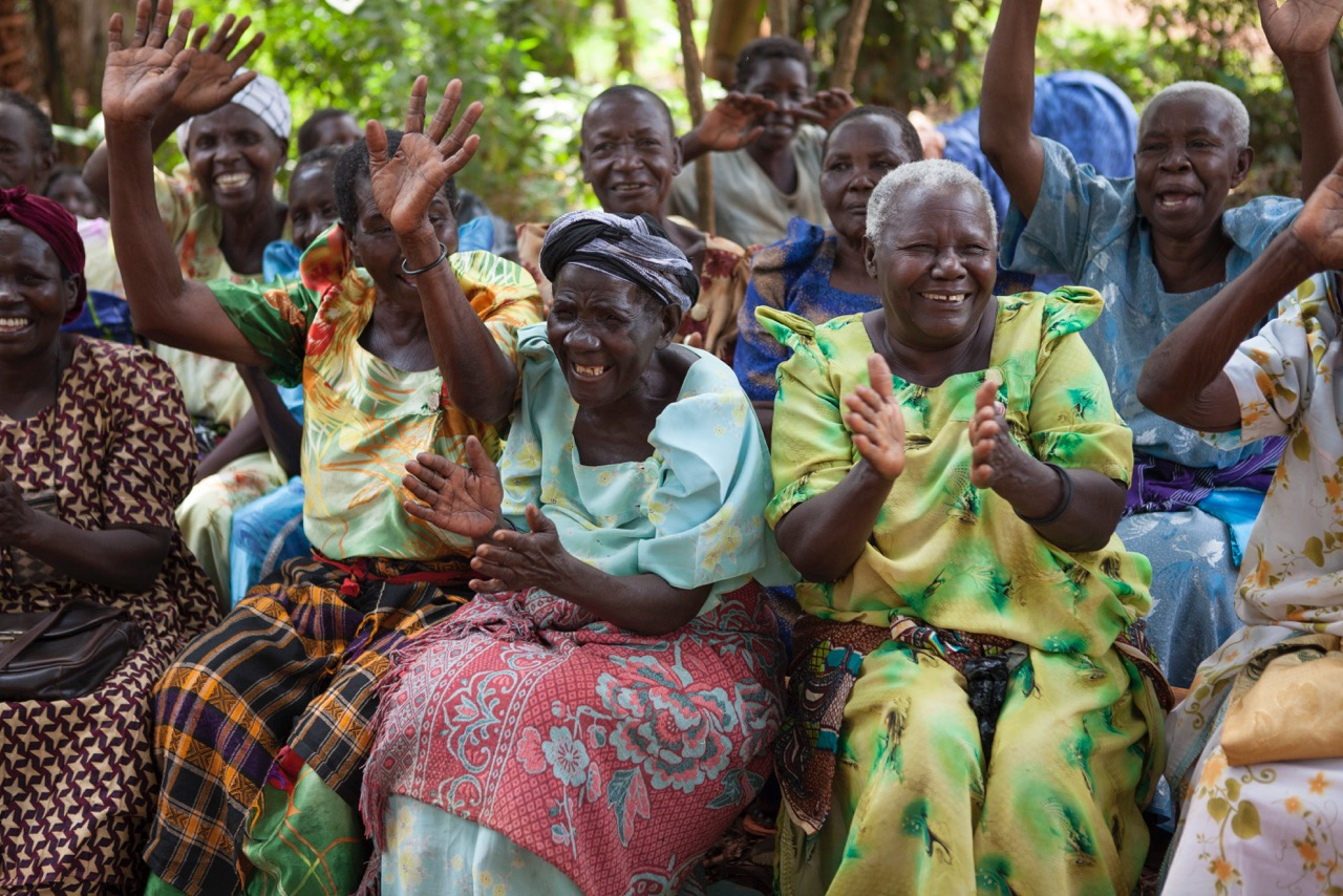 Grandmothers gather in a mutual support group facilitated by the Phoebe Educational Fund for Orphans and Vulnerable Children (PEFO), an organization dedicated to helping grandmothers and children affected by HIV/AIDS in eastern and central Uganda claim their human rights.