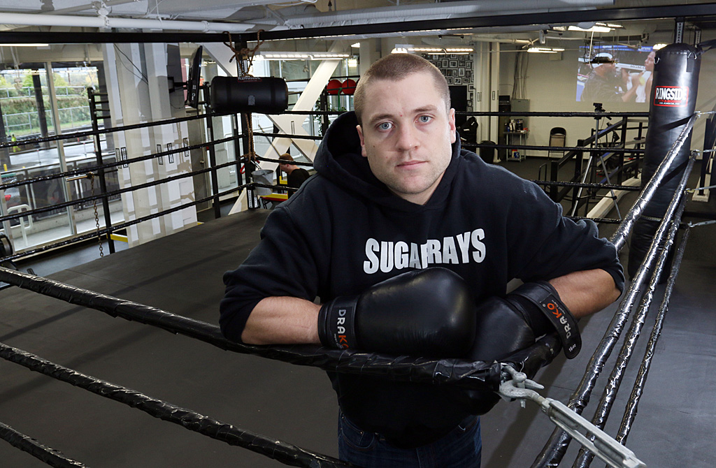 Brennan Williams takes a break in the custom-built ring at his new Sugarray's Boxing Gym on Front Street.