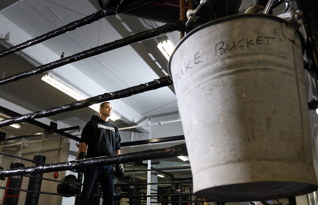 Brennan Williams, of Sugarray's Boxing Gym, says a boxer's training workout can be grueling. That may explain the puke bucket hanging in a corner of the gym's custom-built ring.