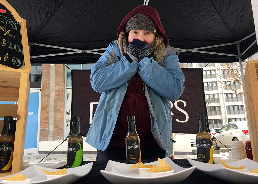 The hot sauces at Roasters may warm the insides, but Tara is relying on six layers and Hot Pockets to keep her outsides toasty at Saturday's chilly Winter Farmer's Market.